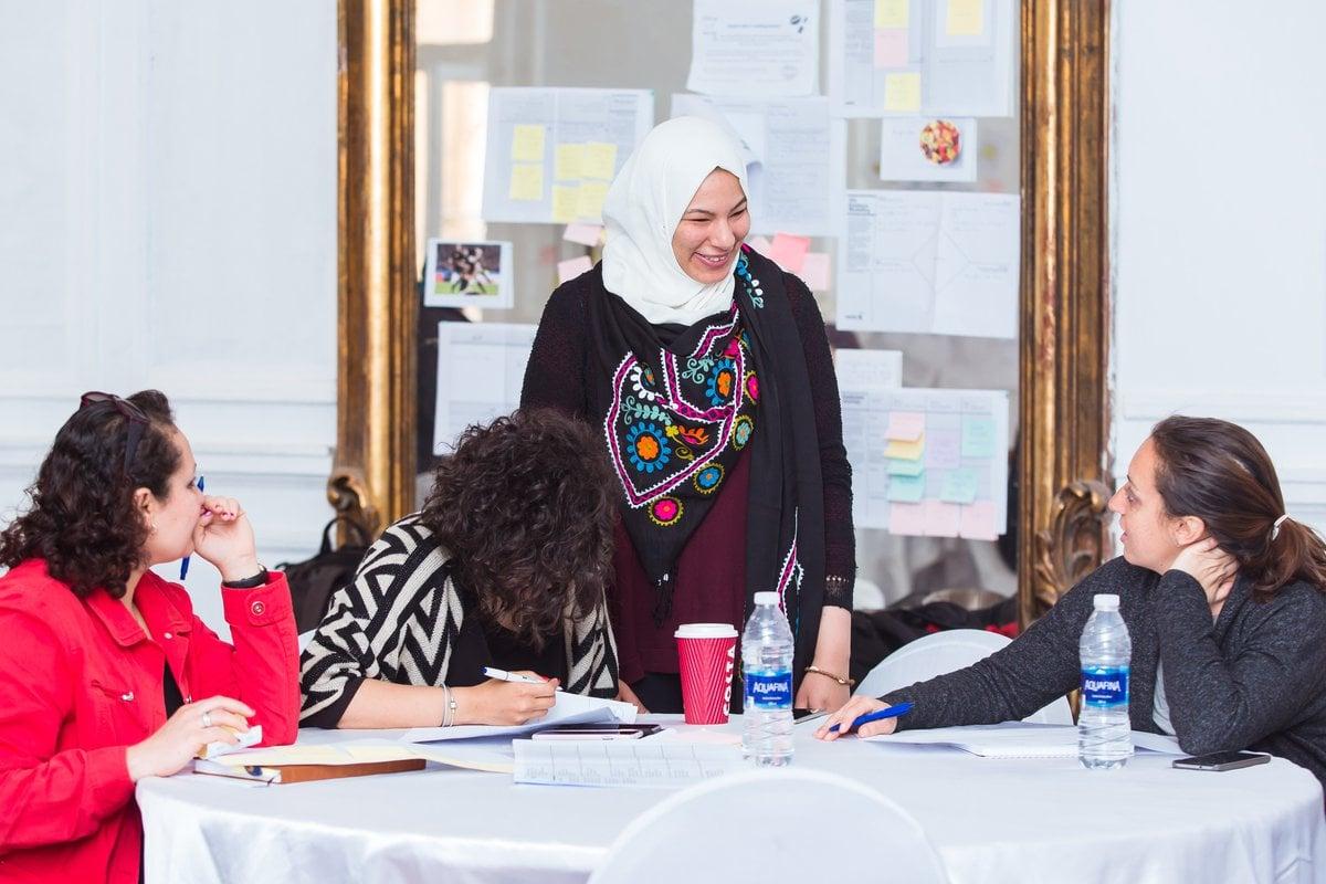 Esraa Fathy, Egyptian workshop associate, speak to Creative Enterprise Programme participants