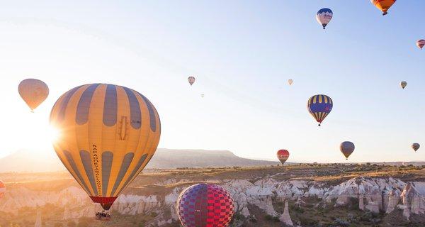 Hot air balloons over sunrise