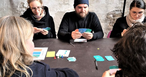 "People playing ""Cards for the Future"" in Berlin"