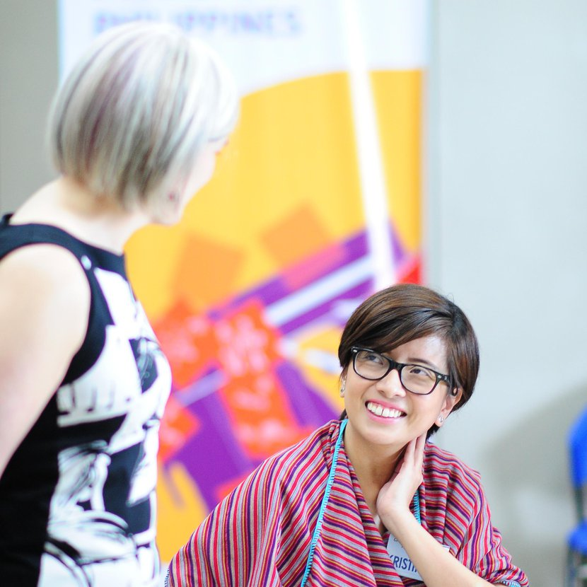 Catherine Doherty (left) with a participant at the Creative Enterprise Programme workshop in The Philippines