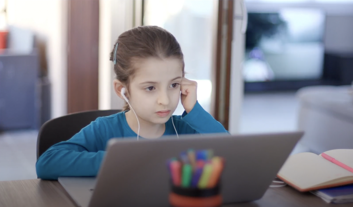Child being tutored online