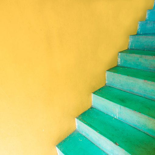 Yellow wall and green stairs