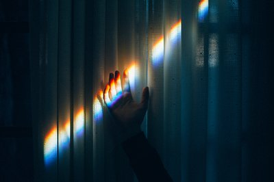 Hand in rainbow beam