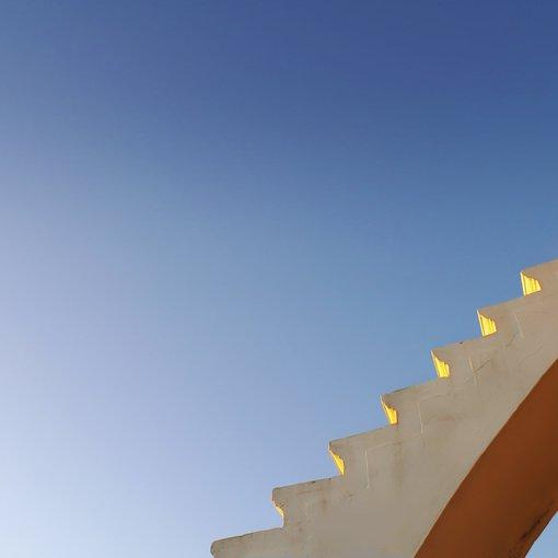 Concrete stairs against blue sky homepage hero