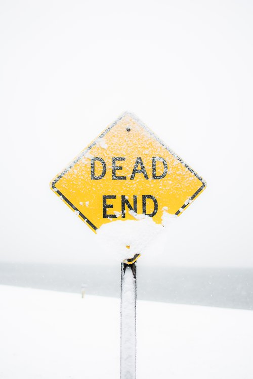 Dead End sign covered in snow