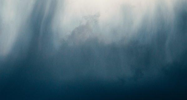 Black and blue smoke on white background