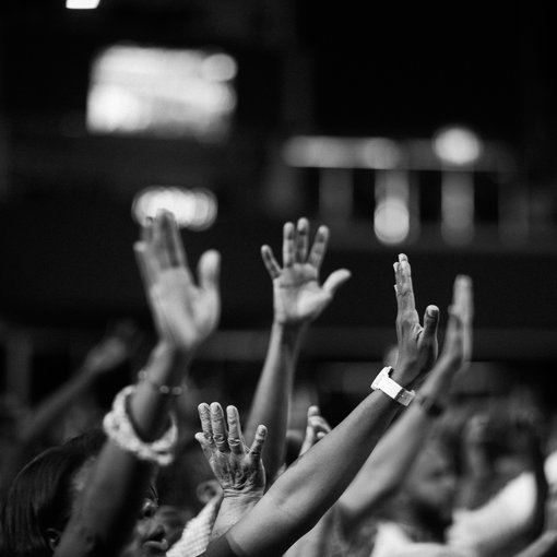 grayscale-photography-of-people-raising-hands-2014775.jpg