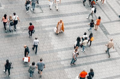 People walk on a paved area