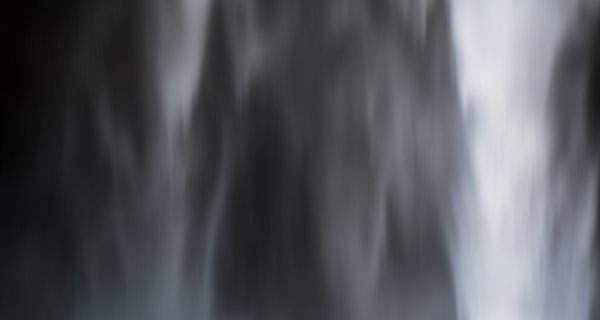A blurred image of a waterfall