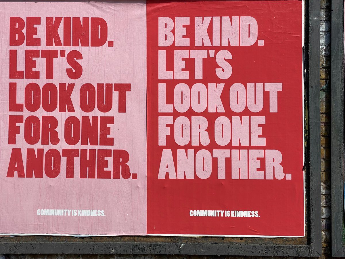 Two red and pink posters that say 'Let's be kind. Look out for one another.'