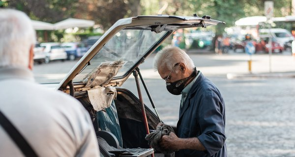 male-in-face-mask-taking-things-out-of-car-trunk-4558411-cropped.jpg