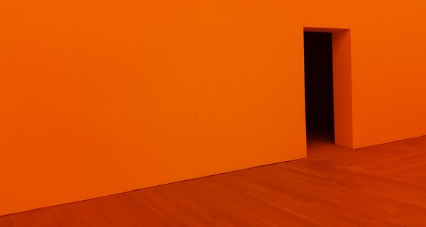 Orange wall with a door