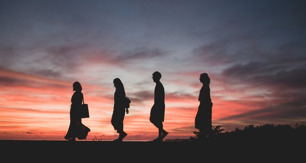 Four people at sunset