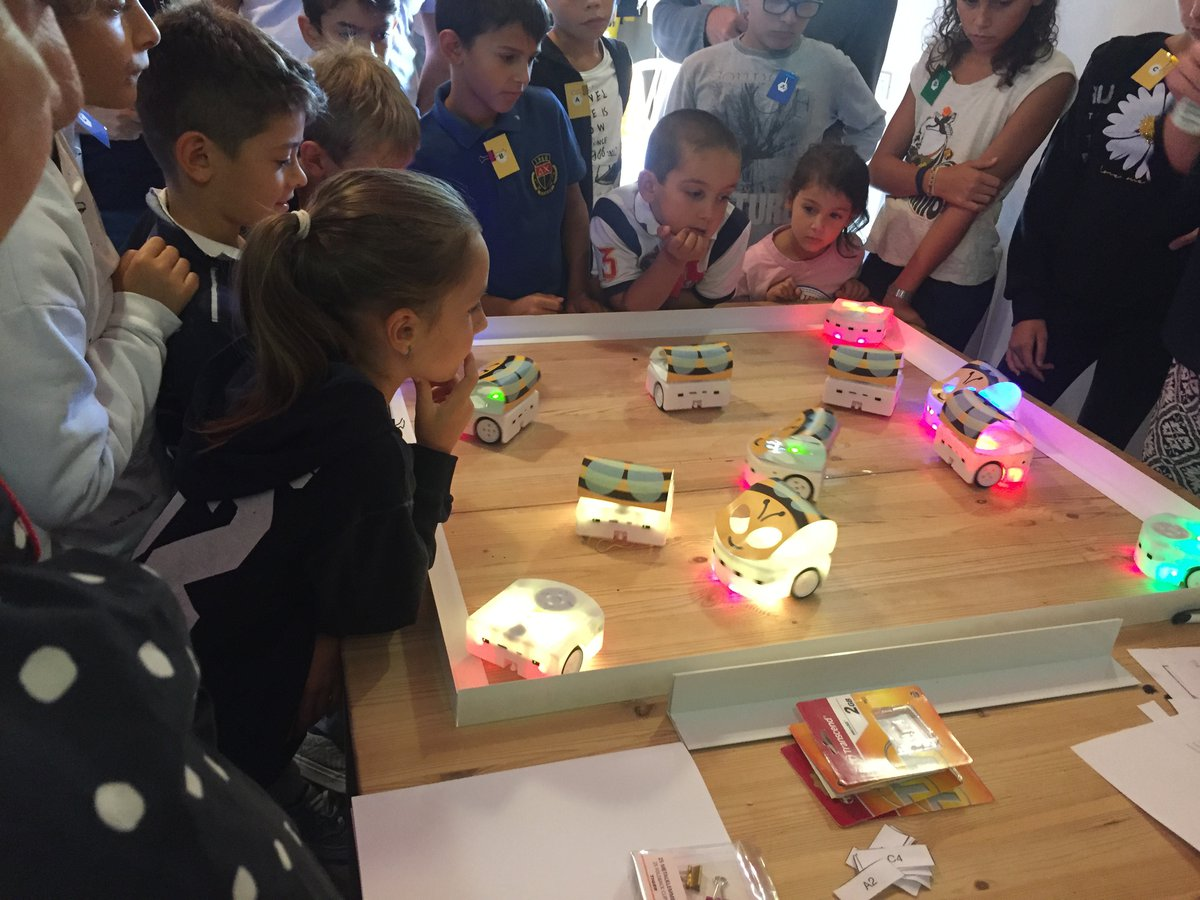 Children looking at mechanical bees