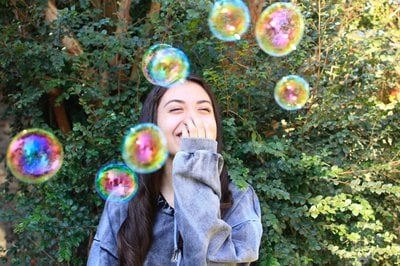 Woman enjoys bubbles