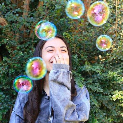 Woman enjoys bubbles